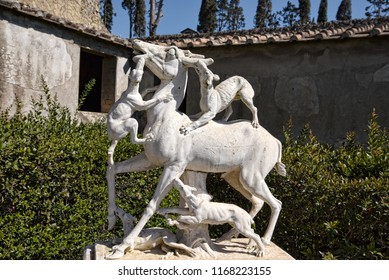 Herculanium, Campania /Italy -April 07 2018. Ruins of Herculaneum buried by the eruption of Vesuvius in 79AD. This is a statue of Actaeon turned into a stag by Diana and torn to pieces by her dogs