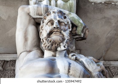 Hercules as Atlant. Detail of the facade decoration mansion XVIII century. Influence of weather conditions on the architecture of St. Petersburg, Russia.