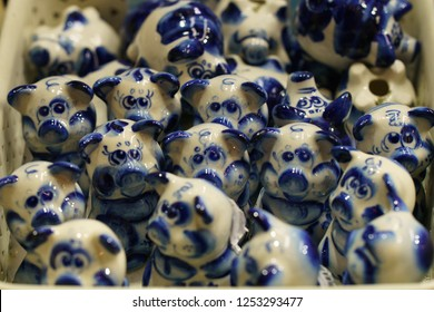 The herd of ceramic Gzhel toys-pigs. Gzhel is traditional russian design of the plates, figurines, etc. - blue painted porcelain items.