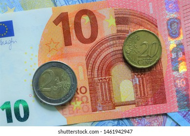 Here is a 10 euro note, with a 2 euro coin, 20 cent euro coin and three 20 euro notes