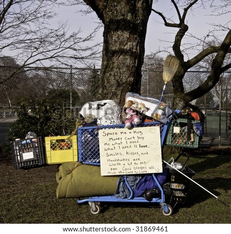 Here is a homeless persons belongings. All he needs is a hug.
