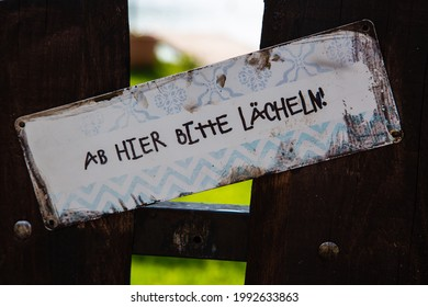 From here on, please smile, signboard on Garden (ab hier bitte lächeln = ab hier bitte lächeln)