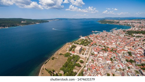 Here is where two continentals meet. Europe and Asia. Drone view of Canakkale. City center and bosporus of Marmara sea. Panoramic drone photo of Canakkale city and castle.