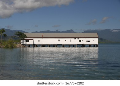 The heritage listed Port Douglas Wharf on the Coral Sea at Port Douglas, Queensland, Australia.