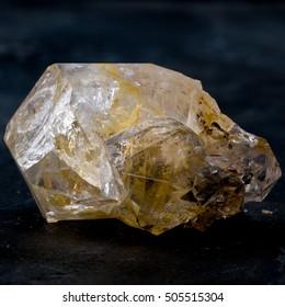 Herkimer Diamond crystal specimen on dark slate background