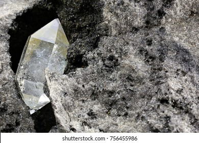 Herkimer diamond nestled in bedrock