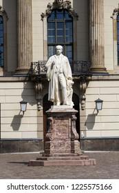 Hermann von Helmholtz statue in front of the Humboldt University, Berlin, Germany, sunny day, sculptor Ernts Herter 1899