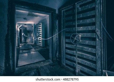 Hermetic doors of entrance of abandoned underground ex Soviet cold war bobm shelter. Ghostly figure walking through.