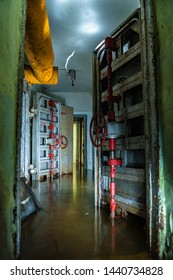 Hermetic metal doors of flooded abandoned Soviet time fallout shelter
