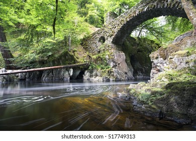 The Hermitage Bridge in Perthshire Scotland with river flowing through in long exposure