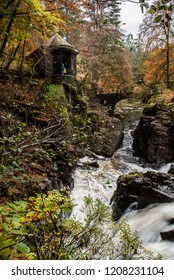 The Hermitage (Dunkeld, Perthshire) in autumn with waterfall, autumnal colours and leaves. Scotland.