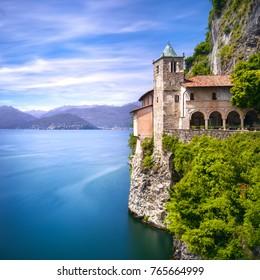 Hermitage or Eremo of Santa Caterina del Sasso medieval roman catholic monastery. Leggiuno Maggiore lake, Lombardy Italy, Europe. Long Exposure.