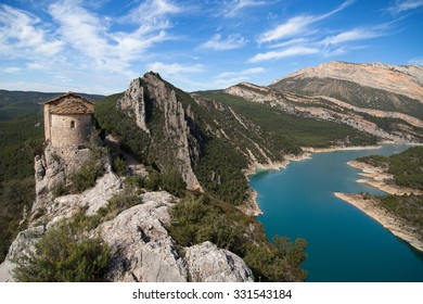 Hermitage of La Pertusa and the Montsec mountains in La Noguera, Lleida, Catalonia.