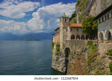 Hermitage of Santa Caterina del Sasso is rock face directly overhanging the lake Maggiore, Leggiuno, Italy