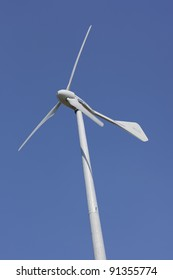 HERMIVAL LES VAUX, FRANCE - JUNE 29: Wind Turbine producing electricity for the zoo Cerza in Hermival les Vaux, France on June 29, 2011. The length of the JIMP 25k wind turbine is 23m.