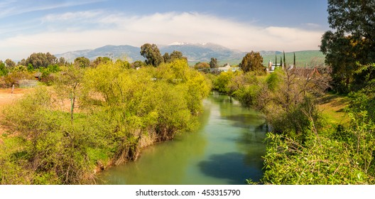 Hermon Mount view via Jordan River. Beautiful panoramic landscape of the mountains of Galilee and Golan Heights via Jordan River. Israel