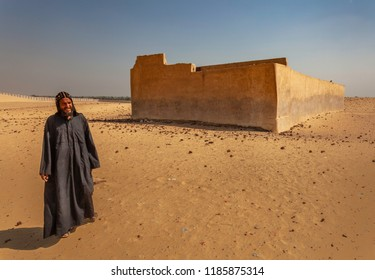 HERMOPOLIS, EGYPT - SEPTEMBER 12, 2018: Coptic monk at orthodox monastery of Saint Fana (Monastery of Abu Fanah) in Western Desert