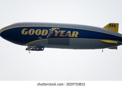 Hermosa Beach, CA: August 19, 2021:  A Goodyear Blimp flying over Hermosa Beach, California. Goodyear owns three airships in its fleet.
