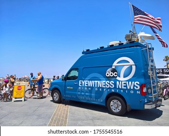 HERMOSA BEACH, CA - JULY 4, 2018: A news van for ABC 7 Los Angeles amongst Beach goers at Hermosa Beach on 4th of July
