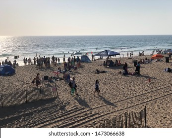 Hermosa Beach, CA: September 2, 2018:    People enjoying the sunny day in Hermosa Beach, California. Hermosa Beach is a popular beach town for people from all over the world.