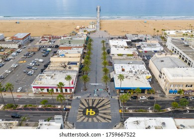 Hermosa Beach, California, Hermosa Beach Pier and intersection with city logo painted on street. Photo taken March 15, 2020.