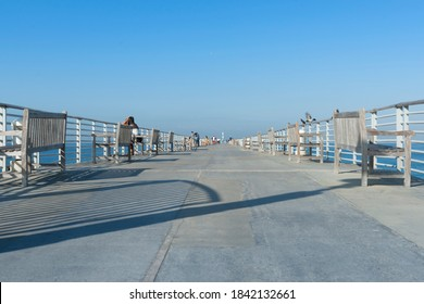 Hermosa Beach USA - October 7 2015; People relaxing, fishing walking on Hermosa Pier on clear summer day California