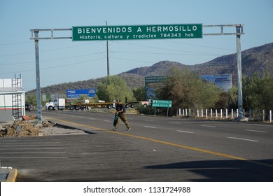 """Hermosillo, Sonora / Mexico, 6/20/2018 - A sign is shown over state highway 15 and reads """"Bienvenidos A Hermosillo""""."""