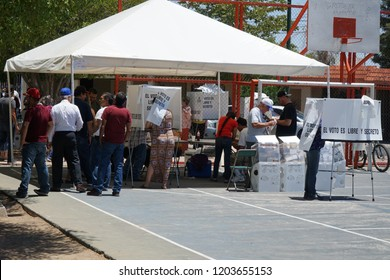 Hermosillo, Sonora / Mexico - 7-1-2018: A basket ball court serves as a polling place for voters which are deciding on electing the new president of Mexico and deciding other local races.