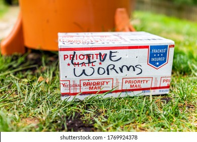 Herndon, USA - April 29, 2020: Live Worms sign on package delivery as priority mail from USPS for garden container compost tower and nobody