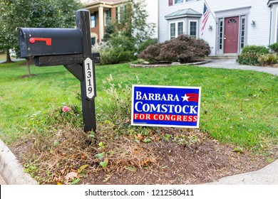 Herndon, USA - October 21, 2018: Political Election sign for Republican Congress woman Barbara Comstock representative on lawn by mailbox in Virginia