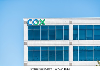 Herndon, USA - October 7, 2020: Cox Communications logo building sign in Northern Virginia for corporate business providing cable internet phone services