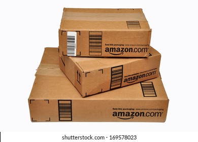 HERNDON, VA, USA - JULY 17, 2012: Three sealed Amazon.com packages stacked on top of each other and isolated on a white background.