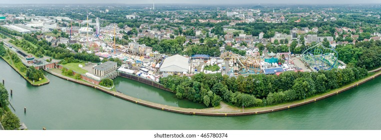 HERNE / GERMANY - AUGUST 08 2016 : The famous funfair Crange under the clouds, aerial panorama