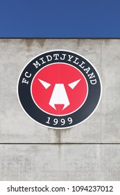 Herning, Denmark - May 13, 2018: FC Midtjylland logo on a wall of the MCH arena. FC Midtjylland is a professional Danish football club  based in Herning and playing currently in superliga