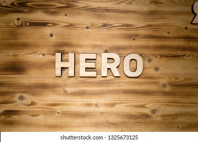 HERO word made of wooden block letters on wooden board