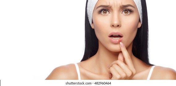 Herpes on lips of the young woman. Shocked woman touching pain her lips. Inflammation of the lip. Herpes on the lips, beauty concept. Beautiful lips infected herpes virus. Woman with herpes virus
