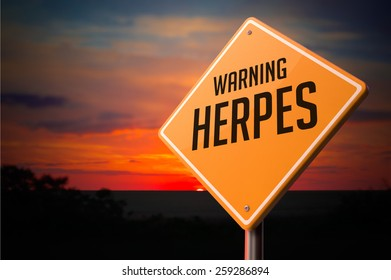 Herpes on Warning Road Sign on Sunset Sky Background.