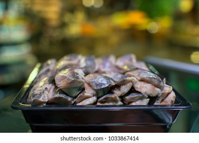 herring in the fish department of the store