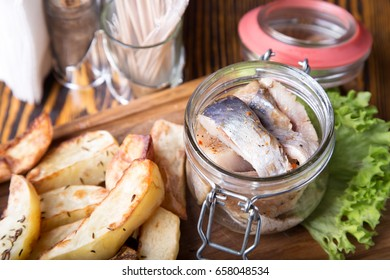 Herring pieces in a glass jar with potato