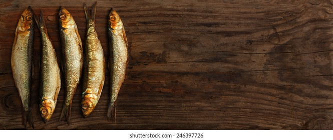 herring sprats smoked wooden oak background
