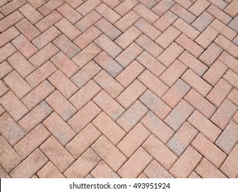 a herringbone pattern created by bricks or pavers