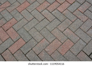 Herringbone seamless pattern of brick pavement for background, backdrop, or texture.