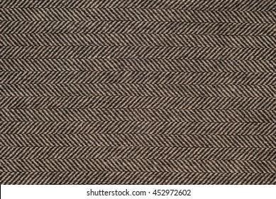 Herringbone tweed background with closeup on wool fabric texture.