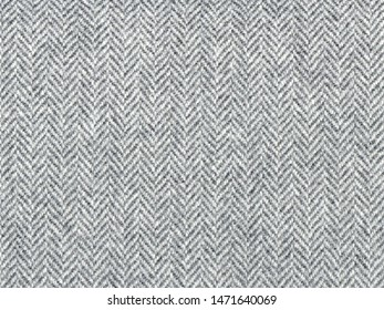 Herringbone tweed, Wool Background Texture. Coat close-up. Expensive men's suit fabric. Virgin wool extra-fine. High resolution.