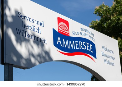 HERRSCHING, BAVARIA / GERMANY - June 1, 2019: Close up of sign above the pier / landing stage in Herrsching. The sign invites tourists and day trippers to take a cruise on a ship at Lake Ammersee.