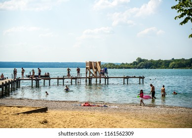 Herrsching,Germany-August 20,2018: Families go swimming in Ammersee lake in a hot summer afternoon