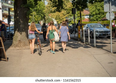 Herrsching,Germany-August 20,2018: People return from swimming in lake Ammersee in warm summer afternoon