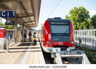 Hersching,Germany-July 14,2018:Passengers board a suburban train bound for Munich airport