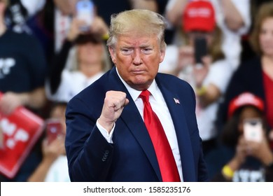 HERSHEY, PA - DECEMBER 10, 2019:President Donald Trump gestures the confident fist pump on stage at a campaign rally at the Giant Center.