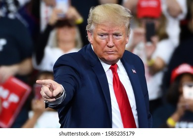 HERSHEY, PA - DECEMBER 10, 2019:President Donald Trump gestures the pointing finger to his supporters during a campaign rally at the Giant Center.
